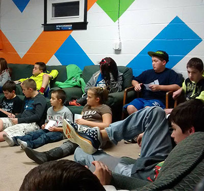Kids seated in the interior of Crossfire Youth Center